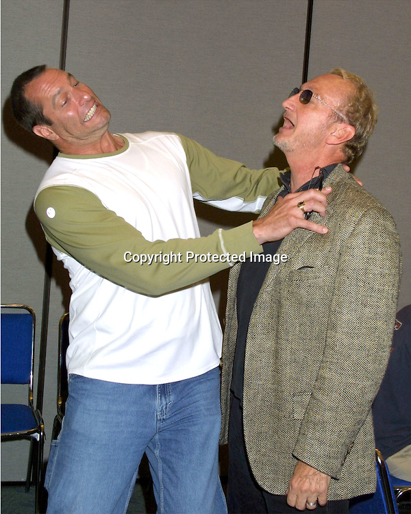 "©2003 KATHY HUTCHINS  / HUTCHINS PHOTO AGENCY.COMICON CONVENTION.SAN DIEGO, CA.JULY 19, 2003..ROBERT ENGLUND ""FREDDY KRUEGER""  AND KEN KINZINGER ""JASON VOORHEES"" PROMOTING THIER UPCOMING RELEASE OF ""FREDDY VS JASON"" IN AUGUST 2003 , BACKSTAGE AT COMICON"