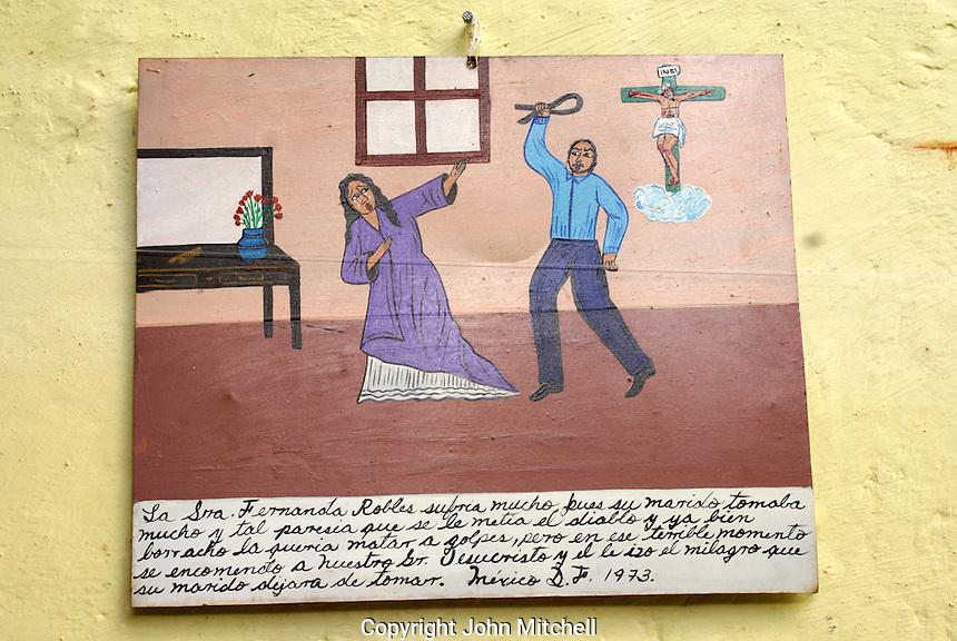 Mexican retablo or ex-voto showing domestic violence,  San Miguel de Allende, Mexico