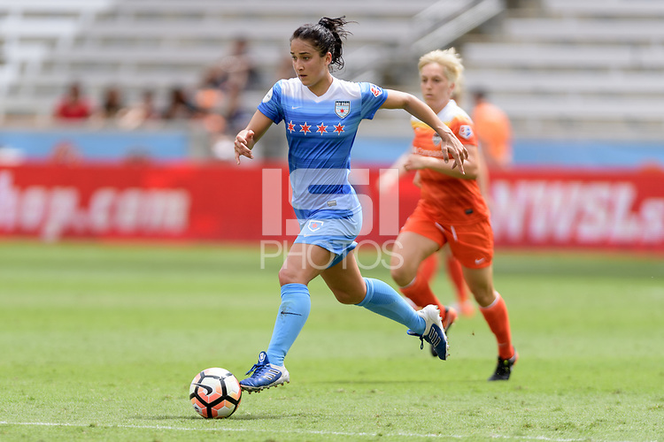Houston, TX - Saturday April 15, 2017: Jennifer Hoy brings the ball up the field during a regular season National Women's Soccer League (NWSL) match won by the Houston Dash 2-0 over the Chicago Red Stars at BBVA Compass Stadium.