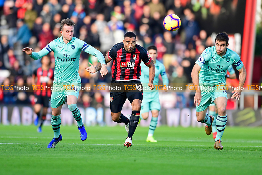 Callum Wilson of AFC Bournemouth middle tangles with Laurent Koscielny of Arsenal16` left during AFC Bournemouth vs Arsenal, Premier League Football at the Vitality Stadium on 25th November 2018