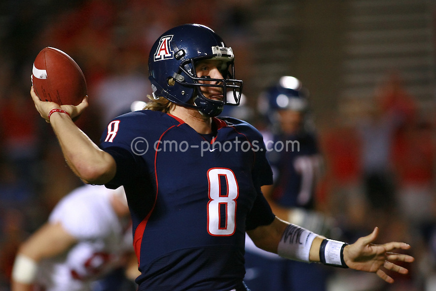 Oct 17, 2009; Tucson, AZ, USA; Arizona quarterback Nick Foles (8) pump-fakes while scrambling in the 4th quarter of a game against the Stanford Cardinal at Arizona Stadium.  Arizona defeated Stanford 43-38.
