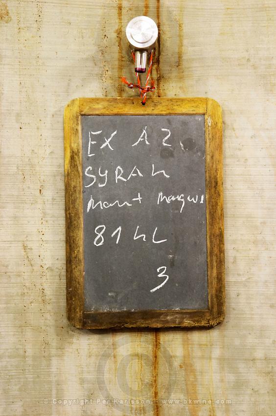 Syrah, 81 hectolitre. Chateau des Erles. In Villeneuve-les-Corbieres. Fitou. Languedoc. Concrete fermentation and storage vats. Sign on tank. France. Europe.