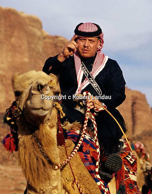 King Abdullah II of Jordan on camel in Wadi Rum