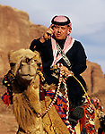 King Abdullah II of Jordan on camel in Wadi Rum