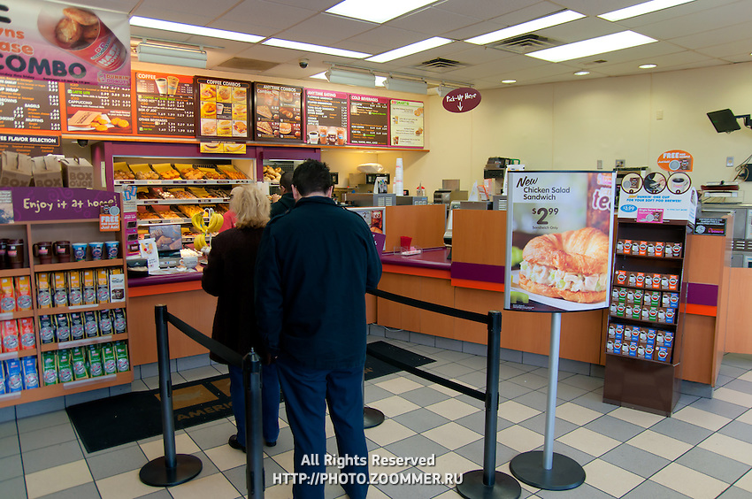 Customers waiting in the line inside Dunkin Donuts restaurant