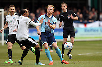 Craig Disley of Grimsby Town (right) battles for the ball with Ricky Modeste of Dover (7) during the Vanarama National League match between Dover Athletic and Grimsby Town at the Crabble Athletic Ground, Dover, England on 16 April 2016. Photo by Tony Fowles/PRiME Media Images.