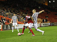 Isaac Osbourne being pressured by Gary Teale in the Aberdeen v St Mirren Scottish Communities League Cup match played at Pittodrie Stadium, Aberdeen on 30.10.12.