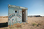 Art-covered former concrete guard station from the former WWII military base at the entrance to Slab City in California's Imperial Valley