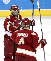 Denver's Drew Shore (No.15) celebrates his goal with Matt Donovan during the first period. Shore's goal tied the game at 2-2. Denver beat Nebraska-Omaha 4-2 Saturday night at Qwest Center Omaha. (Photo by Michelle Bishop)