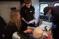 Cynthia Bowman (from left), Arielle Vandette, and Greg Gutoski of Pro EMS work with patient Robert F. Fredo in an ambulance in Cambridge, Massachusetts, USA.  Fredo, 87, was at a doctor's office when the doctor noticed heart irregularities during an examination.  The paramedics took a mobile EKG in the ambulance, which they then send to doctors at the hospital in advance of their arrival with the patient.