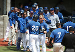 The Wildcats greet Kody Reynolds after he hit a home run against Utah State University Eastern at Western Nevada College in Carson City, Nev., on Saturday, April 25, 2015. <br /> Photo by Cathleen Allison