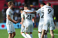George Byers of Swansea City celebrates scoring his side's third goal during the Sky Bet Championship match between Swansea City and Rotherham United at the Liberty Stadium in Swansea, Wales, UK.  Friday 19 April 2019