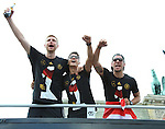 15.07.2014, Brandenburger Tor, Berlin, GER, Weltmeister in Berlin, WM-Empfang, Fans in Berlin, Fanmeile, im Bild <br /> <br />         <br /> <br /> Per Mertesacker (DFB)<br /> Mesut Oezil (DFB)<br /> Lukas Podolski (DFB)<br /> <br /> <br /> Die Spieler kamen mit dem Truck<br /> <br /> <br /> <br /> <br /> Foto &copy; nordphoto /  Schulz