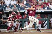 Florida State Seminoles third baseman Drew Mendoza (22) follows through on his swing during Game 2 of the NCAA College World Series against the Arkansas Razorbacks on June 15, 2019 at TD Ameritrade Park in Omaha, Nebraska. Florida State defeated Arkansas 1-0. (Andrew Woolley/Four Seam Images)