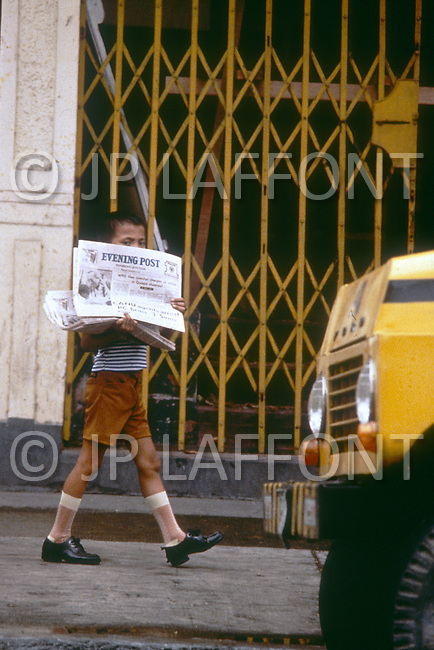 Child is employed to sell newspapers in Manilla, Philippines - Child labor as seen around the world between 1979 and 1980 - Photographer Jean Pierre Laffont, touched by the suffering of child workers, chronicled their plight in 12 countries over the course of one year.  Laffont was awarded The World Press Award and Madeline Ross Award among many others for his work.