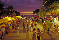 People socialize, dine, and visit the various booths at a fair at the Cuisines of the Sun food festival at the Maunalani Bay Resort on the Big Island in July 2001
