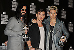 LOS ANGELES, CA. - September 12: Tomo Milicevich, Shannon Leto and Jared Leto of 30 Seconds to Mars pose in the press room at the 2010 MTV Video Music Awards held at Nokia Theatre L.A. Live on September 12, 2010 in Los Angeles, California.