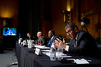 United States Secret Service Assistant Director Michael D'Ambrosio, right, accompanied by from left, Justice Department Associate Deputy Attorney General William Hughes, Justice Department U.S. Attorney Craig Carpenito, and FBI Criminal Investigative Division Assistant Director Calvin A. Shivers, speaks at a US Senate Judiciary Committee hearing on Capitol Hill in Washington, Tuesday, June 9, 2020, to examine COVID-19 fraud, focusing on law enforcement's response to those exploiting the pandemic. <br /> Credit: Andrew Harnik / Pool via CNP/AdMedia