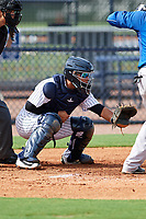 GCL Yankees East catcher Carlos Gallardo (16) awaits the pitch in front of home plate umpire Emma Charlesworth-Seiler during the first game of a doubleheader against the GCL Blue Jays on July 24, 2017 at the Yankees Minor League Complex in Tampa, Florida.  GCL Blue Jays defeated the GCL Yankees East 6-3 in a game that originally started on July 8th.  (Mike Janes/Four Seam Images)