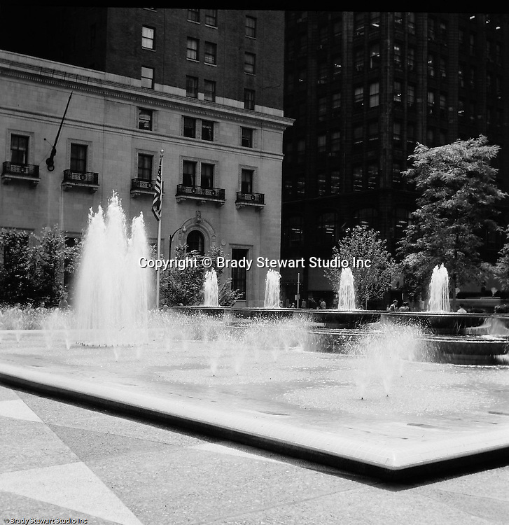 Pittsburgh PA: View of the new Mellon Square - 1955. Mellon Square, built in 1953-55 was designed by Mitchell & Ritchey, landscaped by Simonds & Simonds, and paid for by Mellon family foundations.  Rumor has it that the park was built to keep Alcoa Corporation from moving from Pittsburgh to New York City in the early 1950s.  Other building in the photo include:  William Penn Hotel.
