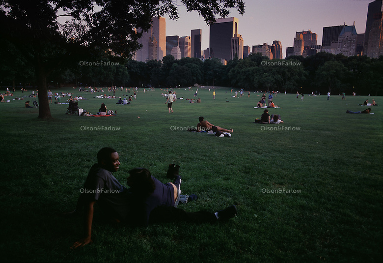 Alone in the crowd in sheeps meadow in Central Park.  Frederick Law Olmsted believed in restorative powers of the outdoors to cure the ills of urban life.