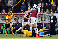 Burnley's Chris Wood controls under pressure from Wolverhampton Wanderers' Ruben Neves (left) and Romain Saiss (grounded)<br /> <br /> Photographer Rich Linley/CameraSport<br /> <br /> The Premier League - Burnley v Wolverhampton Wanderers - Saturday 30th March 2019 - Turf Moor - Burnley<br /> <br /> World Copyright © 2019 CameraSport. All rights reserved. 43 Linden Ave. Countesthorpe. Leicester. England. LE8 5PG - Tel: +44 (0) 116 277 4147 - admin@camerasport.com - www.camerasport.com