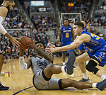 Nevada's Jordan Caroline (24) hands the ball off from the floor against South Dakota State in the second half of an NCAA college basketball game in Reno, Nev., Saturday, Dec. 15, 2018. (AP Photo/Tom R. Smedes)