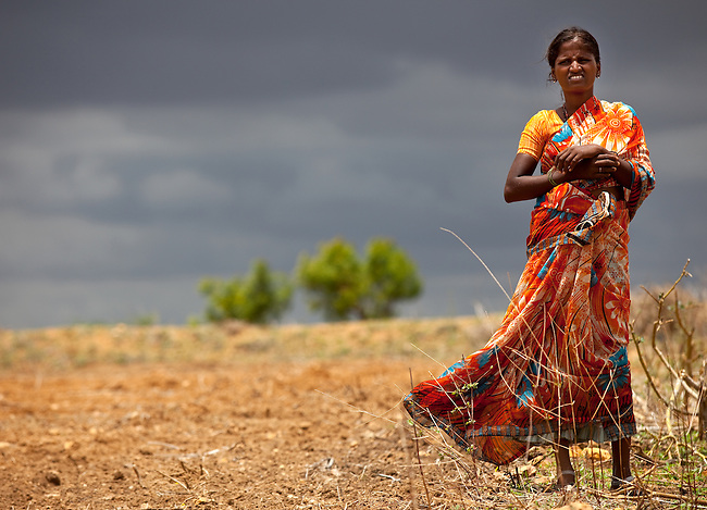 A farm worker in the unsown cotton fields at Bijanegere Village where a lot of children have been used as farm hands by landlords. Located outside of Raichur in Karnatarka, India the Government Primary and Secondary school in the village is benefitting from the IKEA Social Initiative, implemented in conjunction with UNICEF, by identifying child labourers and getting them out of working on farms and into school.Picture by Graham Crouch/UNICEF