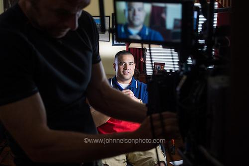 Afganistan war vet Josh Himan goes over a script before taping a video segment at his family's home in Woodbridge, VA.