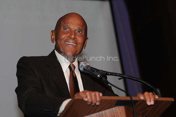 NEW YORK, NY - APRIL 3: Harry Belafonte pictured as David N. Dinkins, 106th Mayor of the City of New York, receives the Dr. Phyllis Harrison-Ross Public Service Award for a lifetime of public service at the New York Society of Ethical Culture in New York City on April 3, 2014. Credit: Margot Jordan/MediaPunch