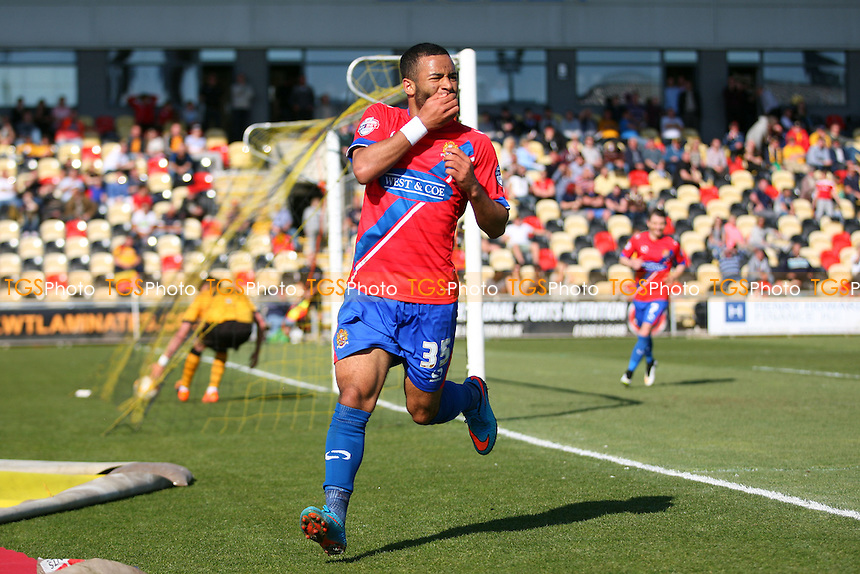 Alex Jakubiak of Dagenham and Redbridge celebrates scoring the third goal - Newport County AFC Dagenham and Redbridge - Sky Bet League Two action at the Rodney Parade Stadium on 18/04/15 - MANDATORY CREDIT: Dave Simpson/TGSPHOTO - Self billing applies where appropriate - 0845 094 6026 - contact@tgsphoto.co.uk - NO UNPAID USE