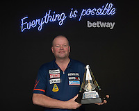 20.05.2015. London,  England. Betway Premier League Darts, Play-Offs Media Day. [L-R] Reigning Premier League Champion Raymond van Barneveld with the Betway Premier League Trophy.
