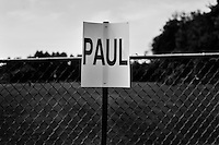 A sign on a fence indicates where supporters of Republican presidential candidate Ron Paul were to gather before the 4th of July parade in Amherst, New Hampshire. Republican presidential candidates Mitt Romney and Jon Huntsman walked in the parade as part of their campaign for the 2012 presidential election.