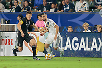CARSON, CA - SEPTEMBER 15: Matt Besler #5 of Sporting Kansas City and Sebastian Lletget #17 of the Los Angeles Galaxy battle for a ball during a game between Sporting Kansas City and Los Angeles Galaxy at Dignity Health Sports Complex on September 15, 2019 in Carson, California.