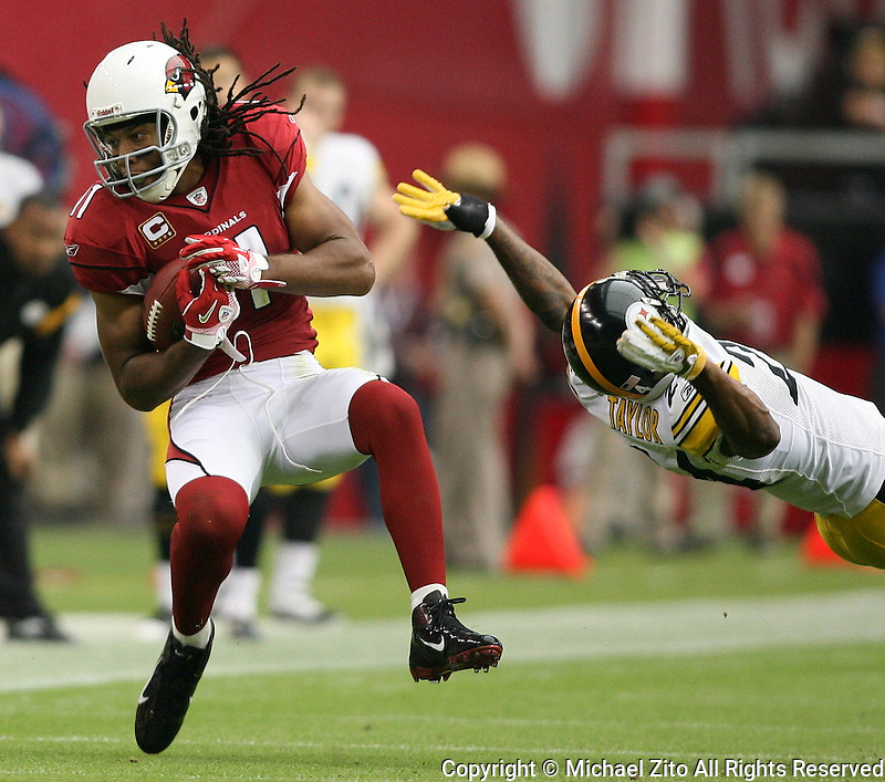 10/23/11 Glendale, AZ: Arizona Cardinals wide receiver Larry Fitzgerald #11, and Pittsburgh Steelers cornerback Ike Taylor #24 during an NFL game played at University of Phoenix Stadium between the Arizona Cardinals and the Pittsburgh Steelers. The Steelers defeated the Cardinals 32-20.