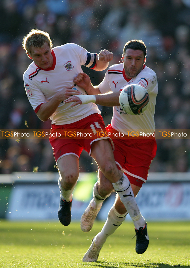 Mark Roberts of Stevenage FC and Jon Ashton of Stevenage FC clash heads as they challenge for the same ball - Charlton Athletic vs Stevenage - nPower League One Football at the Valley, London - 25/02/12 - MANDATORY CREDIT: Helen Watson/TGSPHOTO - Self billing applies where appropriate - 0845 094 6026 - contact@tgsphoto.co.uk - NO UNPAID USE.