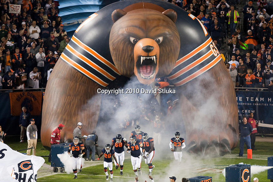 Chicago Bears football team runs onto the field during an NFL football game against the Green Bay Packers in Chicago, Illinois on September 27, 2010. The Bears won the game 20-17. (AP Photo/David Stluka)