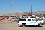 Fire trucks are staged to fight the Sylmar Fire which started near Veterans Park in Sylmar.15 November 2008