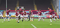 Burnley players warm up in front of the empty stand<br /> <br /> Photographer Dave Howarth/CameraSport<br /> <br /> The Premier League - Burnley v Brighton & Hove Albion - Sunday 26th July 2020 - Turf Moor - Burnley<br /> <br /> World Copyright © 2020 CameraSport. All rights reserved. 43 Linden Ave. Countesthorpe. Leicester. England. LE8 5PG - Tel: +44 (0) 116 277 4147 - admin@camerasport.com - www.camerasport.com