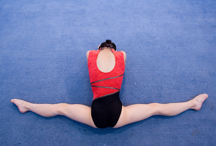A girl warms up before a training session in Beijing.