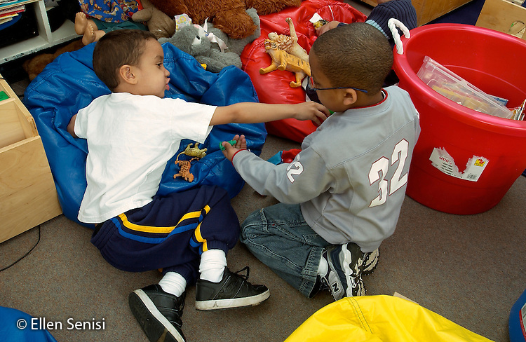 MR / Schenectady, NY.Yates Arts-in-Education Magnet School               .Full day pre-K class; urban public school               .State funding thru NYS Universal Pre-K Program.Boys (4, African-American) argue over toy at free playtime..MR: Wil23 Pal2.©Ellen B. Senisi