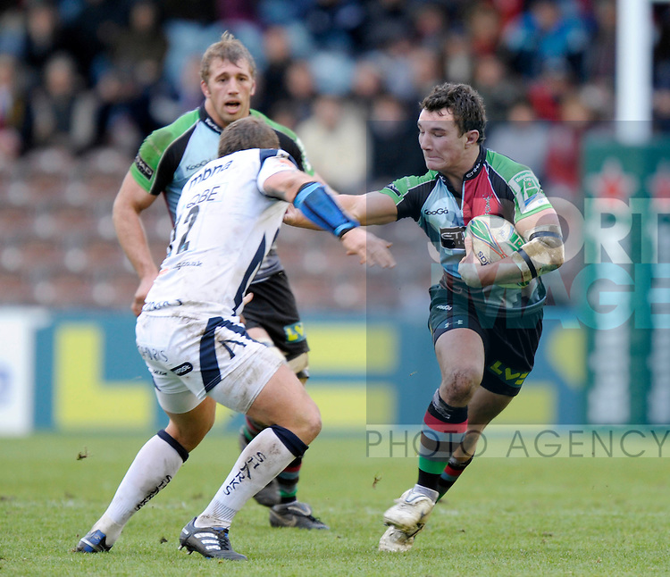 Harlequins George Lowe hands off Sale Shark's Lee Thomas
