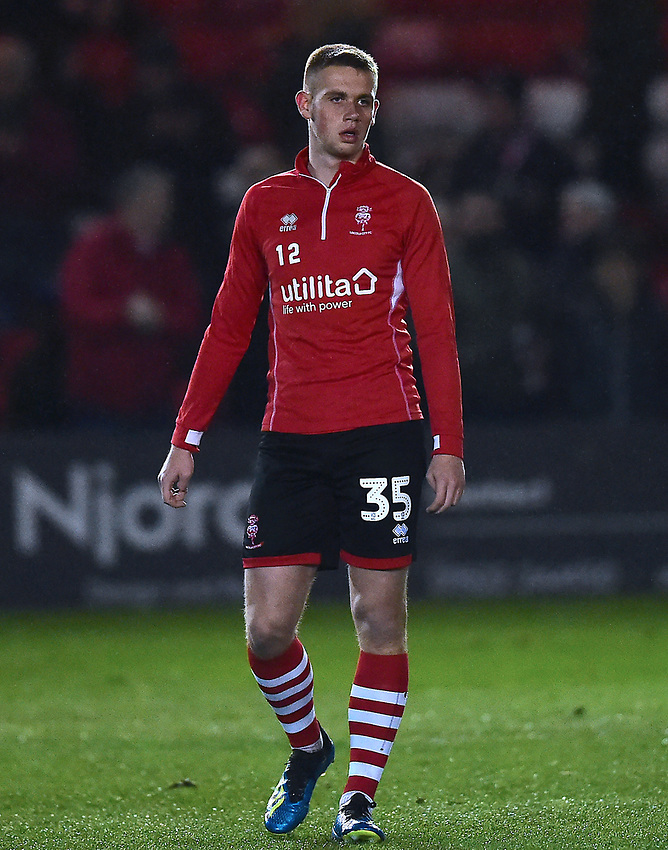 Lincoln City's Kyle Watkins during the pre-match warm-up<br /> <br /> Photographer Andrew Vaughan/CameraSport<br /> <br /> The EFL Sky Bet League Two - Lincoln City v Yeovil Town - Friday 8th March 2019 - Sincil Bank - Lincoln<br /> <br /> World Copyright © 2019 CameraSport. All rights reserved. 43 Linden Ave. Countesthorpe. Leicester. England. LE8 5PG - Tel: +44 (0) 116 277 4147 - admin@camerasport.com - www.camerasport.com