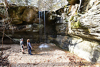 NWA Democrat-Gazette/FLIP PUTTHOFF <br /> Dennis and Linda Heter gaze at a waterfall Jan. 18 2019  tucked away in the forest at the Madison County Wildlife Management Area. The 14,000 acre tract of public land administered by the Arkansas Game and Fish Commission is located between Huntsville and Eureka Springs. February and March are ideal times to look for waterfalls at the wildlife management area.