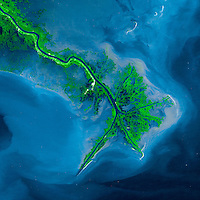 Mississippi River Delta, October, 2001. Left to their own devices, rivers change course over time, and the Mississippi is no exception. Geologists surmise that the Mississippi changed course numerous times over the past 10,000 years, wandering across a roughly 320-kilometer (200-mile) range along the Gulf Coast. The Mississippi probably settled on its current course some six centuries ago.