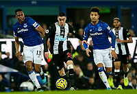 Newcastle United's Miguel Almiron gets away from Everton's Yerry Mina and Mason Holgate<br /> <br /> Photographer Alex Dodd/CameraSport<br /> <br /> The Premier League - Everton v Newcastle United  - Tuesday 21st January 2020 - Goodison Park - Liverpool<br /> <br /> World Copyright © 2020 CameraSport. All rights reserved. 43 Linden Ave. Countesthorpe. Leicester. England. LE8 5PG - Tel: +44 (0) 116 277 4147 - admin@camerasport.com - www.camerasport.com