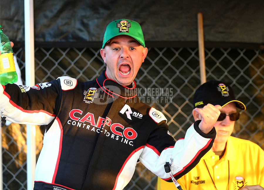 Feb 13, 2016; Pomona, CA, USA; NHRA top fuel driver Steve Torrence celebrates after qualifying number one during qualifying for the Winternationals at Auto Club Raceway at Pomona. Mandatory Credit: Mark J. Rebilas-USA TODAY Sports