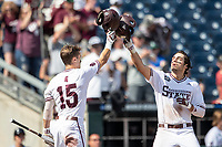 Mississippi State Bulldogs third baseman Marshall Gilbert (34) is greeted at the plate by teammate Jake Mangum (15) after hitting a home run during the seventh inning of Game 8 of the NCAA College World Series against the Vanderbilt Commodores on June 19, 2019 at TD Ameritrade Park in Omaha, Nebraska. Vanderbilt defeated Mississippi State 6-3. (Andrew Woolley/Four Seam Images)