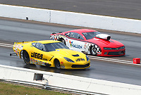 Sep 4, 2017; Clermont, IN, USA; NHRA pro mod driver Troy Coughlin Sr (near) races alongside Jonathan Gray during the US Nationals at Lucas Oil Raceway. Mandatory Credit: Mark J. Rebilas-USA TODAY Sports