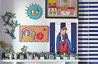 A collection of ceramic cacti and religious icons decorates one of the walls in the kitchen